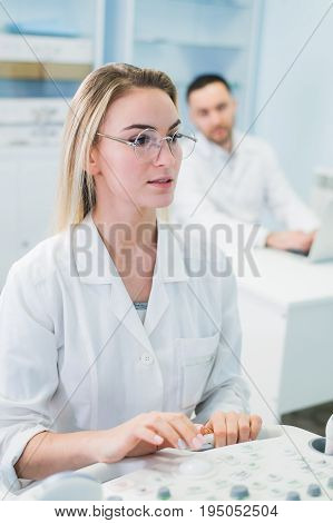 researchers team work at computer scientific analysing data out scientific test in chemistry laboratory.