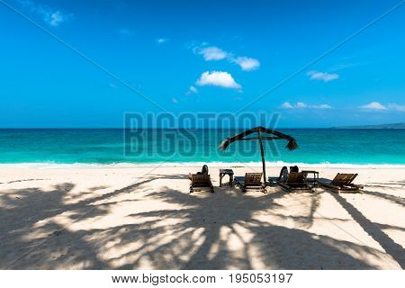 BORACAY WESTERN VISAYAS PHILIPPINES - JANUARY 14 2015: Two people lying down under the tent to protect from the sun at Puka Beach.