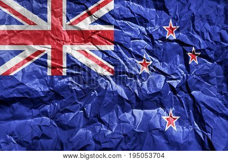 New Zeland flag painted on crumpled paper background