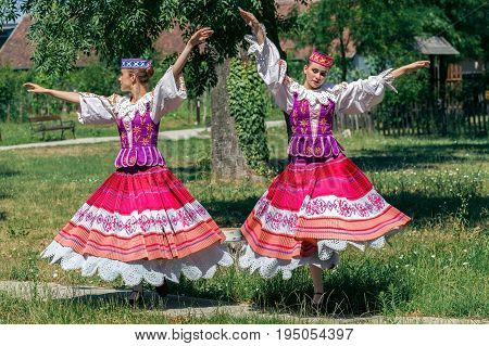 ROMANIA TIMISOARA - JULY 9 2017:Young Belorussian dancers in traditional costume repeat for the show at the international folk festival