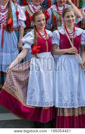 ROMANIA TIMISOARA - JULY 6 2017: Young singer girls from Poland in traditional costume present at the folk festival