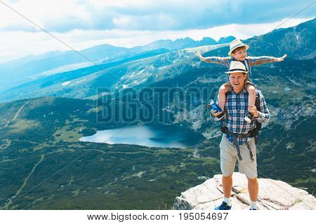 Father and son hiking in Rila mountains, Bulgaria.