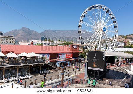 Cape Town South Africa - March 02 2017: The Cape Wheel at the V&A Waterfront with Table Mountain in the background