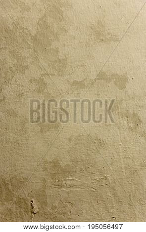 Old yellow dirty grunge wall background with empty space