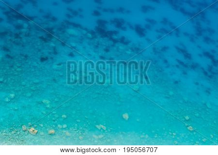 Transparent clean sea water off the coast, a gradient of blue from the beach to the depth  for background, aerial view