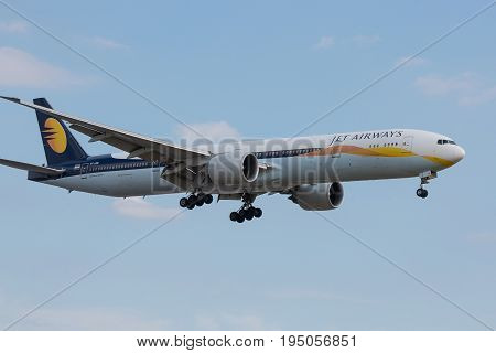 LONDON UK - JULY 9 2017: Plane Boeing 777 Jet Airways Airlines landing at London Heathrow Airport