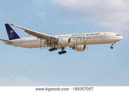 London UK - July 9 2017: Boeing 777 Saudi Arabian Airlines landing at London Heathrow airport