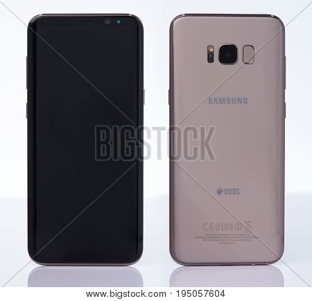New york, USA - July 11, 2017: Back and front view samsung s8+ smartphone isolated on white background.