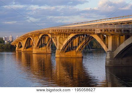 Metro bridge in Kiev hit by the evening sun. Ukraine