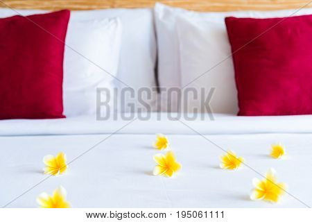 Hotel Room With Bed And Flower Arrangement