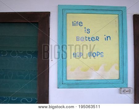 Sign of Life Is Better In Flip Flops, on wall of old house, Nicaragua, Central America