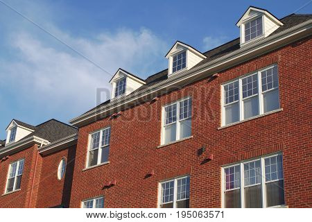 residential house dormers red brick wall windows habitation modern apartment