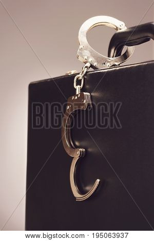 Handcuffs on a Briefcase