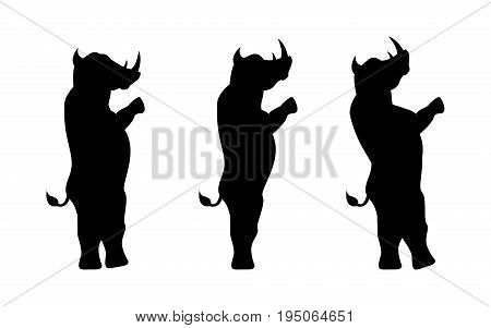 Rhinoceros silhouette stands on two legs isolated on white background