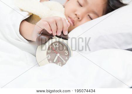 Hand Girl Reaching To Turn Off Alarm Clock