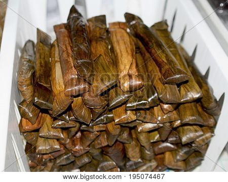 Suman is a Philippine favorite made of sticky rice in banana and cooked in coconut milk.