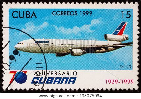Moscow Russia - July 11 2017: A stamp printed in Cuba shows passenger aircraft Douglas DC-10 series