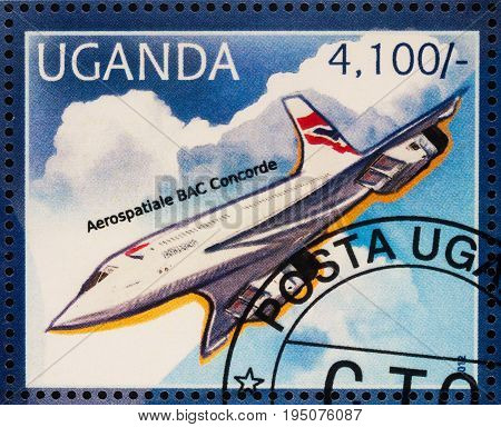 Moscow Russia - July 10 2017: A stamp printed in Uganda shows supersonic passenger airliner Concorde series