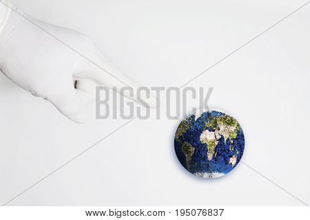 Hand pointing to the blue globe on white background. Element of this image furnished by Nasa. illustration design.