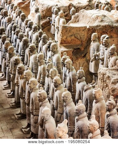 XI'AN SHAANXI PROVINCE CHINA - OCTOBER 28 2015: Side view of the Terracotta Warriors inside the Qin Shi Huang Mausoleum of the First Emperor of China.