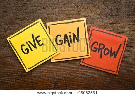 give, gain and grow word abstract - personal development concept, handwriting on sticky notes against rustic wood