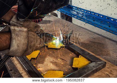 Welder Weld A Metal Welding Machine In A Workshop