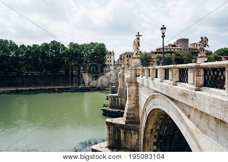 Rome Italy - August 18 2016: Bridge of Castel Sant Angelo. The Mausoleum of Hadrian usually known as Castel Sant'Angelo is a towering cylindrical building in Rome