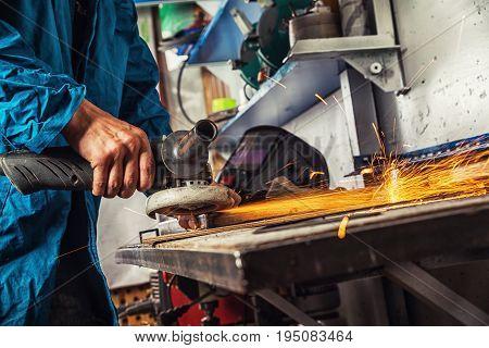 Man Grinds A Metal