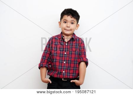 Portrait of funny little boy in red and blue flannel, isolated on white