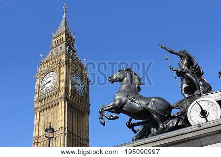 view of Big Ben through bronze sculptural group of Boadicea and Her Daughters at the Westminster Bridge, London, UK