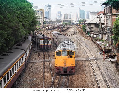 BANGKOK, THAILAND - July 10,2017: Trains moveing out from platform of railway station Hua Lamphong. Hua Lamphong station opened in 1916 and serves apprx 70,000 passengers and 150 trains each day