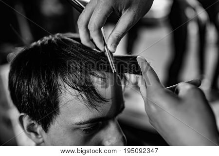 Hair styling in the salon black and hite image close up