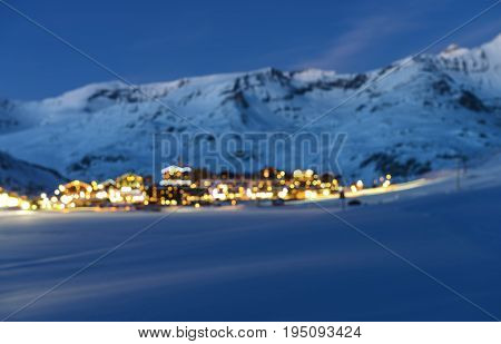 Fuzzy photographic effect : landscape and ski resort in French Alps at night with lightsTignes Tarentaise France
