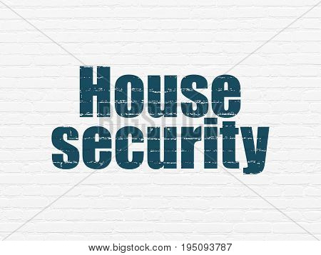 Safety concept: Painted blue text House Security on White Brick wall background