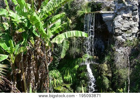 Waterfall in a public garden of the city