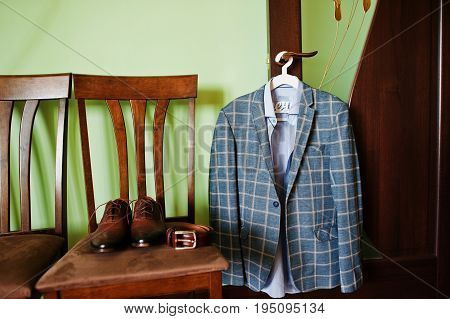 Awesome Groom's Clothing Is Hanging On The Wall Before The Wedding Ceremony.