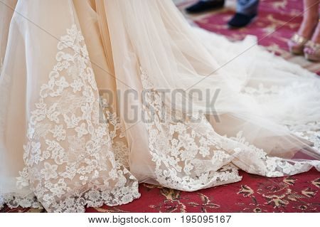 Fantastic Close-up Photo Of Wedding Dress On A Bride In A Church.