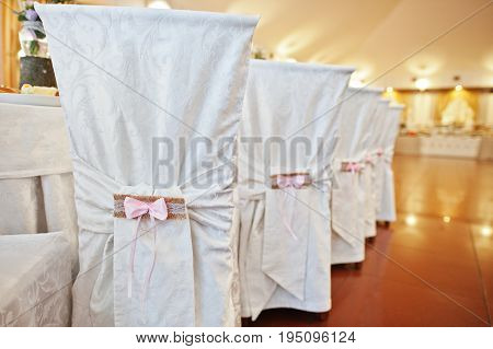 Beautifully Decorated Restaurant Chairs For Wedding Celebration.