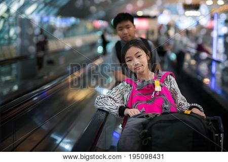 Asian student transit between flight in international airport walking and baggage transportation between station people and travel concept