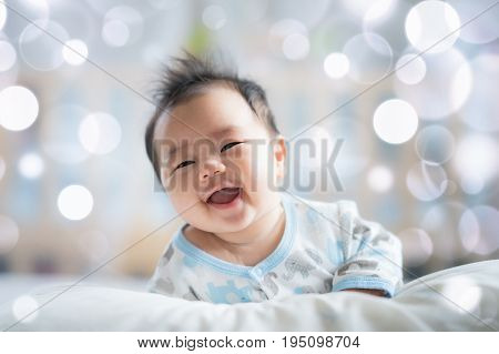 Newborn boy smile on the bed baby newborn and kid concept.
