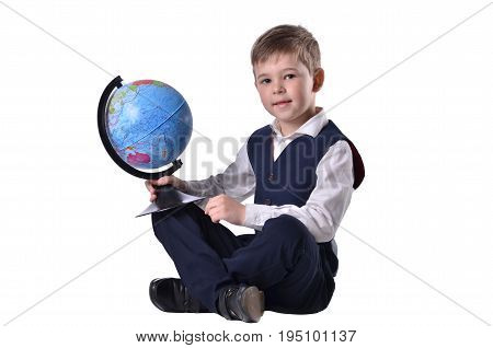 Siiting schoolboy hold a globe of world, isolated on white background