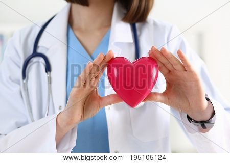 Female Medicine Doctor Hands Holding Red Heart