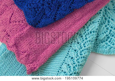 Knitted fabric of light blue purple and dark blue color. Knitwear with patterns