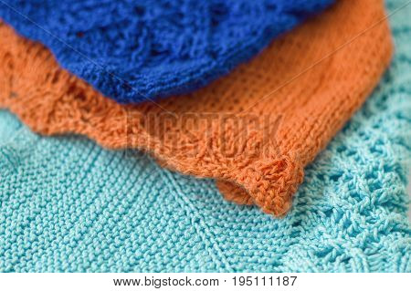 Knitwear of orange blue and light blue color. Knitted fabric