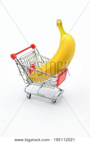 banana in shopping cart on white background