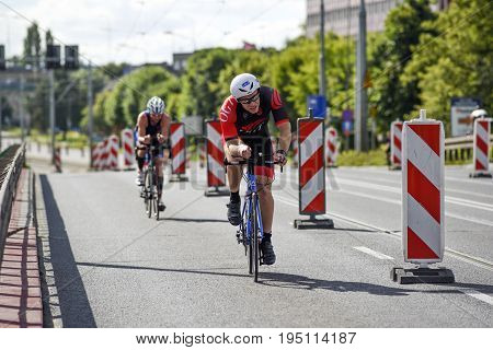 Szczecin Poland July 9 2017: Triathlon Szczecin Triathletes riding on bicycles.