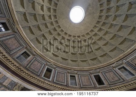 Pantheon in Rome. Inside view. Ray of sunlight passing through a hole in the ceiling. Pantheon was built as a temple to all the gods of ancient Rome. Rome Italy. June 2017