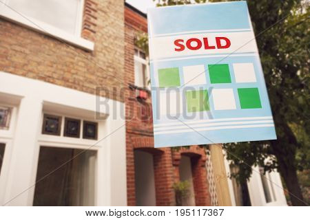 Sold sign in front of new house