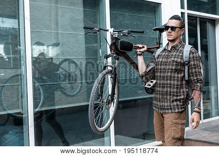 Handsome Young Man With Glasses Carries Bicycle On His Shoulder Lifestyle Daily Routine Concept