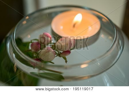 Decorated wedding table with flowers and the candle
